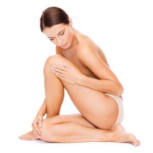 woman feeling skin